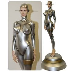 Fantasy Figure Gallery Sexy Robot 002 Human Face Statue.  Do androids dream of electric sheep?  Yamato makes the fantasy world of Hajime Sorayama a reality!  This Sexy Robot Statue appears to be fashioned of molten silver!  Stands about 22-inches tall on a specially designed base.
