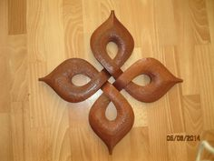 . Work by Boris Kopilevich. http://boriska2009.wix.com/wood-and-metal