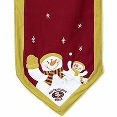 """San Francisco 49ers 72x15"""" Team Snowman Table Runner by Casey's. $28.95. Decorate your table with this Snowman Table Runner. 72"""" long by 15"""" wide, this plush table runner features a snowman parent and child at each end dressed in your favorite team's colors, along with the team logo and embroidered stars. Add the Table Top Snowman Family to complete the look!"""