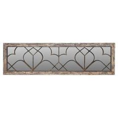 "Bring classic appeal to your entryway or home library with this mirrored wall decor, showcasing an iron overlay and a whitewashed finish.  Product: Wall decor Construction Material: Iron, fir wood, engineered wood and mirrored glassColor: Antiqued whitewash frameFeatures: Geometric overlayDimensions: 18"" H x 63"" W x 1"" D"