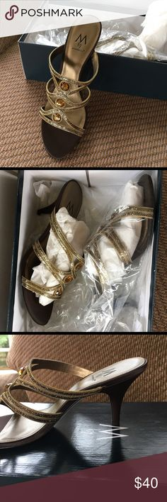 PRICE CUT Beautiful NWT gold heels Fashionable and never worn. Look glamorous at your holiday party in these beautiful gold tone dazzling heels. Feel free to make an offer! Shoes Heels