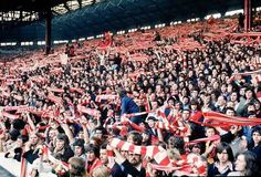 Liverpool fans raise their scarfs aloft on the Kop in 1972