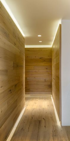 This wood covered hallway has hidden lighting to light the way. Imagine the floor lighting as just a skirting board. Corridor Lighting, Strip Lighting, Interior Lighting, Lighting Ideas, Cove Lighting Ceiling, Indirect Lighting, Apartment Lighting, Ceiling Lighting, Industrial Lighting