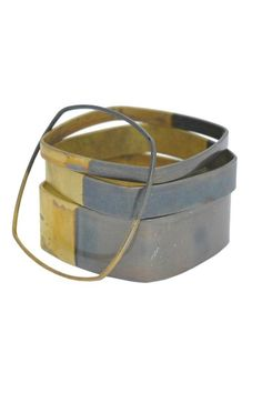 Set of 4 squared off bangles in different sizes.   Half raw brass and half grey patina give the bangles an edginess.      Thickness from largest to smallest:  25mm, 13mm, 6mm, 3mm   Each bangle has a 62mm diameter.   Geometric Bangle Set by We Dream In Colour. Accessories - Jewelry - Bracelets New York City