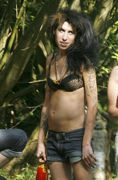 FILE PHOTO dated Sunday, May 11, 2008 of Amy Winehouse taking a break from a recording studio outside of London. The 27-year-old Grammy Award-winning singer has been found dead in her London home. The cause of death is currently unknown.