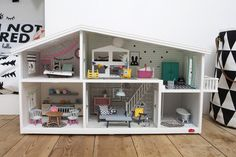 We bought Dixie this Lundby Dolls House for her 2nd birthday last year - well, it was for all of us really! I wallpapered it at the time with some mini versions