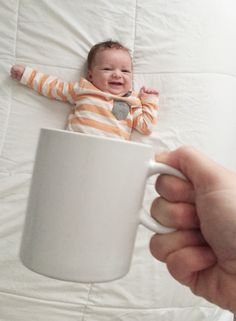 Stay at home mom!? Get creative put your baby in your mug Supplies: Baby Flat surface Two hands Coffee mug
