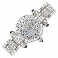 White Gold, Diamond and Sapphire 'Imperiale' Wristwatch, Chopard  18 kt., quartz, centering a circular diamond-set dial with sapphire dot ma...