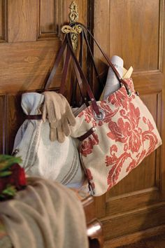 French Laundry carryall bags are ideal for taking along on a weekend getaway. The vintage fabric and leather straps provide a stylish look,