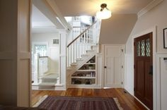 Love the doors and bookcase under the stairs