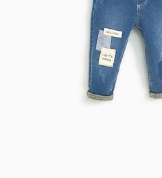 JEANS WITH PATCHES AND FAUX SHEARLING