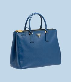 Prada $1960... I don't see this bag in my future...but a girl can dream...I'll take brown or black!