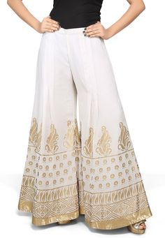 <ul><li> Faux georgette palazzo enhance with foil print in ornamental print along the hemline</li><li> It has a cotton lining</li></ul> Gharara Designs, Salwar Designs, Blouse Designs, Pakistani Dress Design, Pakistani Dresses, Indian Dresses, Indian Designer Outfits, Designer Dresses, Fashion Pants