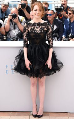 Oh la la! Emma never disappoints, but this ruffled organza Oscar de la Renta dress is a new level of chic for the actress at the Irrational Man photo call.