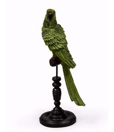A beautifully detailed parrot on wooden perch to bring a touch of tropical to your home. The green on the textured feathers gives it incredible tones. made from resin with a wooden base. Parrot, Exotic, Tropical, The Incredibles, Green, Bedroom Ideas, Snacks, Decor, Decorating