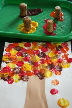 Fall Tree Cork painting. I did this with my kids at work, and they loved it!. They all had very different takes on what a fall tree looked like. - Danielle Danbrea