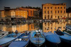 Glowing buildings in de boat harbor in Mediterranean Sea, Piran_ Slovenia