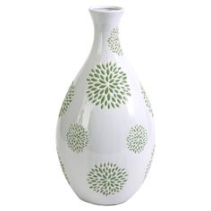 Featuring a green floral motif, this lovely ceramic vase adds colorful appeal to your decor.   Product: VaseConstru...