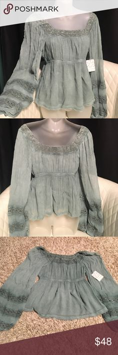 """NWT Free People long sleeve NWT Free People off the shoulder blouse. Fully lined. 100% Rayon. Lining is 65% Rayon 35% Cotton. Crocheted lace is 100% Cotton. Shoulder to hem 21"""". Pit to pit 15"""" with slight stretch. Elasticized empire waistband Free People Tops Blouses"""