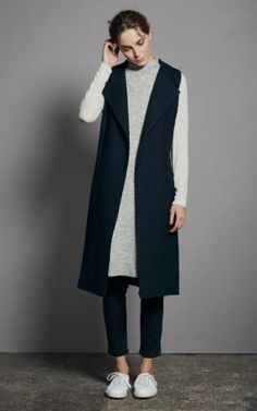 Grey Longline Side Split Tunicm £89; Waistcoat, £299; Kickflare jeans, £69; Trainers, £89, all Mint Velvet Premium. Available September.