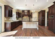 dark wood cabinets with white island..