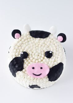 This Cow Cake tutorial makes for an easy and adorable fondant and frosting decorated cow cake; perfect for any cow-themed celebration. Get the recipe! Cow Cakes, Cupcake Cakes, Animal Cakes For Kids, Kids Animals, Animal Birthday Cakes, Cow Birthday Cake, Cake Designs For Kids, Dolphin Cakes, Elephant Cakes