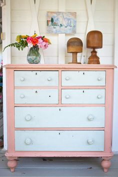 Beautiful vintage pine chest of drawers with original pink and duck egg blue paint job.