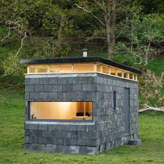 """Eight pop-up """"glamping"""" cabins built to tour the Welsh countryside Slate Cabin by Trias studio Off Grid Cabin, Stone Facade, Tiny House Cabin, Green Architecture, Little Houses, Tiny Houses, Green Building, Glamping, House Plans"""