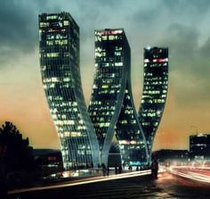 Walter Towers in Prague, Czech Republic. The architects for this wavy modern marvel is the Bjarke Ingels Group. The structure is a combination of office and residential space, all connected within a W formation. A curious thing would be the elevators...