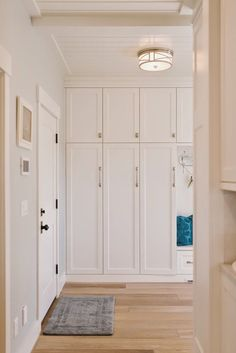 Mud room storage cabinets with doors - clutter out of sight!