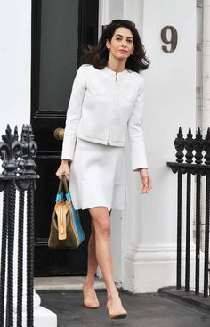 Amal Clooney was thrust into the spotlight after meeting and marrying George Clooney, but she's handled it all with grace and style. Click through to see her top style moments so far. Amal Clooney, George Clooney, Business Formal Women, Business Casual Attire, Professional Attire, White Skirt Suit, White Dress, Skirt Suits, Teal Outfits