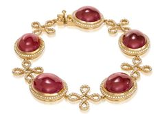 Cabochon Ruby Infinity Bracelet---  Oval cabochon ruby stations surrounded with diamonds alternate with double infinity shapes, also accented with diamonds, along this link bracelet. 18k yellow gold 83.96 cts. t.w. rubies 2.17 cts. t.w. diamonds      SKU 7519     Brand V. Tse     MSRP $50,000.00
