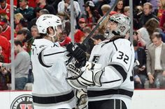 CHICAGO, IL - MARCH 25: Drew Doughty #8 and goalie Jonathan Quick #32 of the Los Angeles Kings celebrate after the Kings defeated the Chicago Blackhawks 5 - 4 during the NHL game on March 25, 2013 at the United Center in Chicago, Illinois. (Photo by Bill Smith/NHLI via Getty Images)