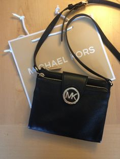 Michael Kors bag with many rooms inside.  #michaelkors