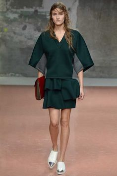 Marni sport ruffle mini in green with hospital blocked sweat top and pointy loafers is a daywear high point. Marni Fall 2014 Ready-to-Wear Collection Slideshow on Style.com
