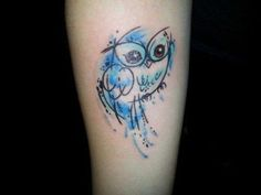 26 - tatto small owl on the lower arm
