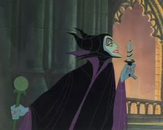 "Original hand painted and hand inked production animation cel of Maleficent set on a lithographic background from ""Sleeping Beauty,"" 1959, Walt Disney Studios; With original Art Corner Certificate sticker; Size - Maleficent: 6 1/4 x 7 1/2"", Image 7 3/4 x 10"", Mat 11 x 14""; Single matted."