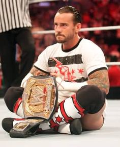CM Punk and his WWE Championship belt