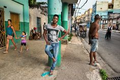 _DSC8532, Cuba. 7/17/2015, CUBA-10290. Man leans against a pillar on a street in Cuba. retouched_Ekaterina Savtsova 08/01/2015 SENDING TO MAGNUM