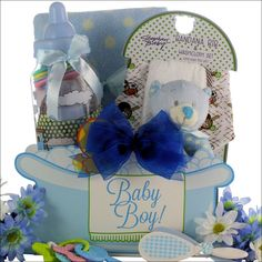 "Baby Boy Essentials Baby Gift Basket Let them know how excited you are about their new baby boy by sending them this ""Baby Essentials"" Baby Boy Gift Basket. It includes a Super Soft Polka Dog Blanket"