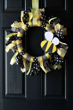Yellow and black wreath at a bumble bees birthday party! See more party planning ideas at CatchMyParty.com!