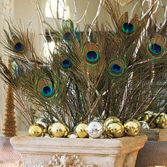 FUse peacock feathers in lieu of traditional holiday flowers for a mantel that makes a statement. When paired with mirrored ornaments and curly willow branches they add just enough color to complement the Christmas tree.   SouthernLiving.com