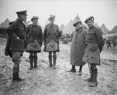 Men of the 9th Highland Light Infantry, WW1 Scottish soldiers wore kilt in battle during WW1. They used small bags over the kilt to carry items. In this photo they are wearing campaign covers to protect their kilts from the weather.