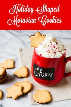 Moravian Sugar Cookies are carefully cut into festive holiday shapes and dipped in rich artisan chocolate!