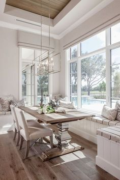 Get inspired by these dining room decor ideas! From dining room furniture ideas, dining room lighting inspirations and the best dining room decor inspirations, you'll find everything here! Dining Nook, Dining Room Design, Dining Room Tables, Dining Room Windows, Built In Dining Room Seating, Dinning Room Chandelier, White Dining Room Table, Beach Dining Room, Conservatory Dining Room