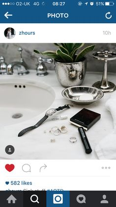 Marble sink and top and silver accessories