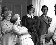 HM Queen Elizabeth II has a hearty laugh  surrounded by her family. Her mother, Queen, Elizabeth, the Queen Mum, Prince Charles and Princess Diana.