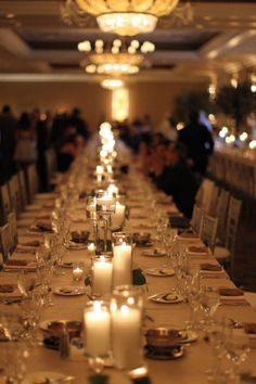 Summer Wedding banquet styled tables filled with lots of candle light