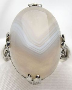 This luscious Art Deco banded agate ring features a luminous cabochon agate. Online at Isadoras.com.