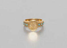 Silver gilt signet ring with 6 turquoisesWeight : 6,18g. Crafted in a fine silver-gilt adorned with six turquoises, this signet ring is fully customizable. Ava